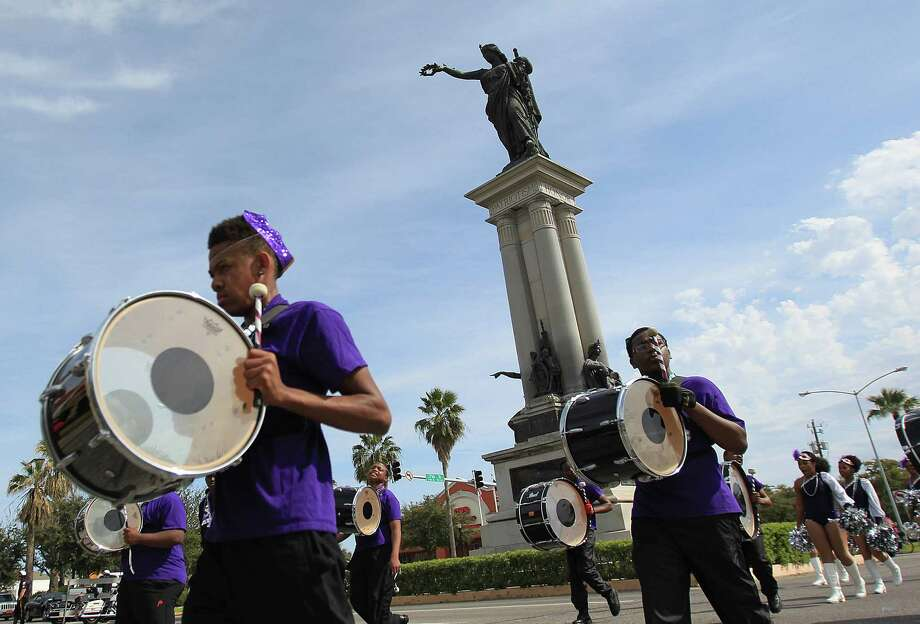 Marching bands perform along 25th Street as The Mystic Krewe of Aquarius 29th Annual Mardi Gras Parade travels along the new parade route on Saturday, Feb. 22, 2014, in Galveston. Photo: Mayra Beltran, Houston Chronicle / © 2014 Houston Chronicle