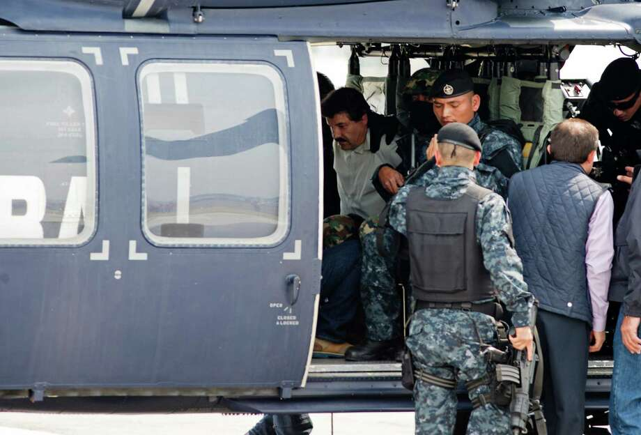 "Joaquin ""El Chapo"" Guzman sits inside a federal police helicopter at a navy hanger in Mexico City, Saturday, Feb. 22, 2014. A senior U.S. law enforcement official said Saturday, that Guzman, the head of Mexico'­s Sinaloa Cartel, was captured alive overnight in the beach resort town of Mazatlan. Guzman faces multiple federal drug trafficking indictments in the U.S. and is on the Drug Enforcement Administration'­s most-wanted list. Photo: Eduardo Verdugo, STF / AP"