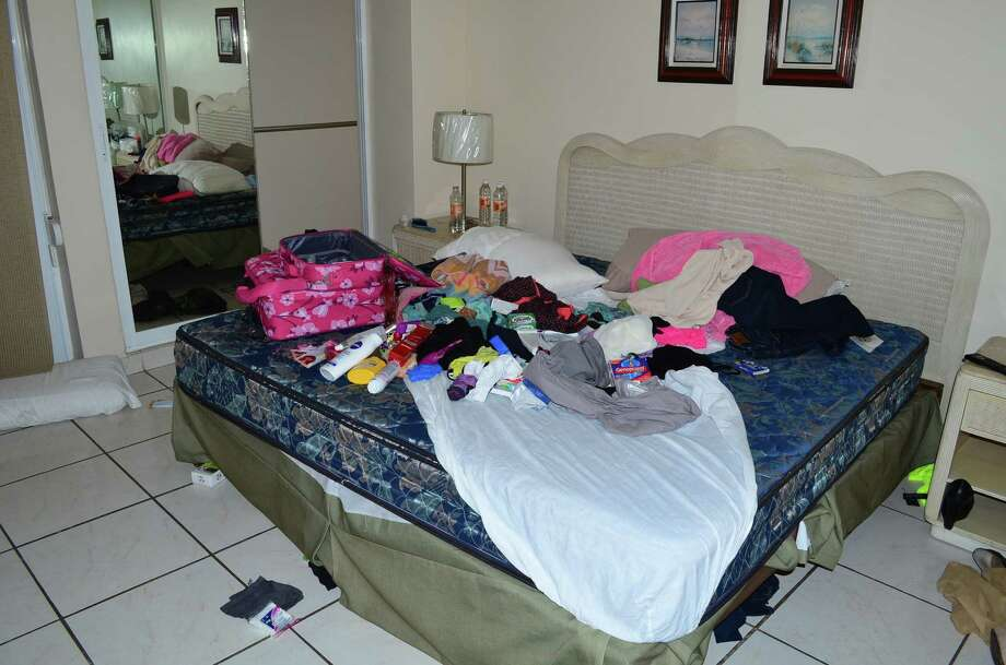 "Clothes and toiletries are scattered on a bed of the hotel room where famed drug boss Joaquin ""El Chapo"" Guzman was arrested, in Mazatlan, Mexico, Saturday Feb. 22, 2014. At the moment of his arrest, Guzman was found with an unidentified woman, said one official not authorized to be quoted by name, adding that the U.S. Drug Enforcement Administration and the Marshals Service were ""heavily involved"" in the capture. No shots were fired. (AP Photo/El Debate de Mazatlan) MEXICO OUT, NO PUBLICAR EN Mé‰XICO Photo: SUB / El Debate de Mazatlan"
