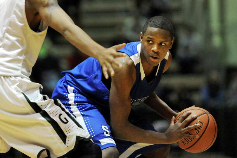 Shaker's Will Francis, right, looks to pass during their Class AA basketball quarterfinal game again