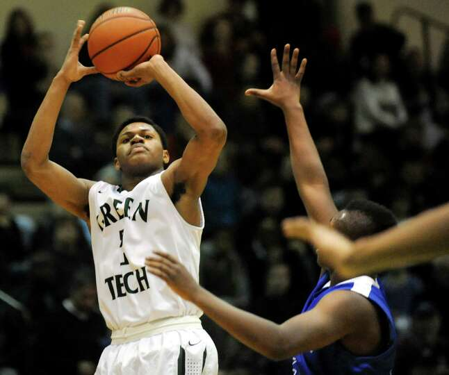 Green Tech's Najee Ward, left, shoots for the hoop during their Class AA basketball quarterfinal gam