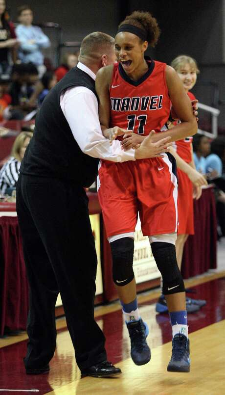 Brianna Turner, right, celebrates with coach Bryan Harris as the clock winds down on Manvel's 58-42 Class 5A Region III final win over Cypress Woods. Photo: Eric Christian Smith, Freelance