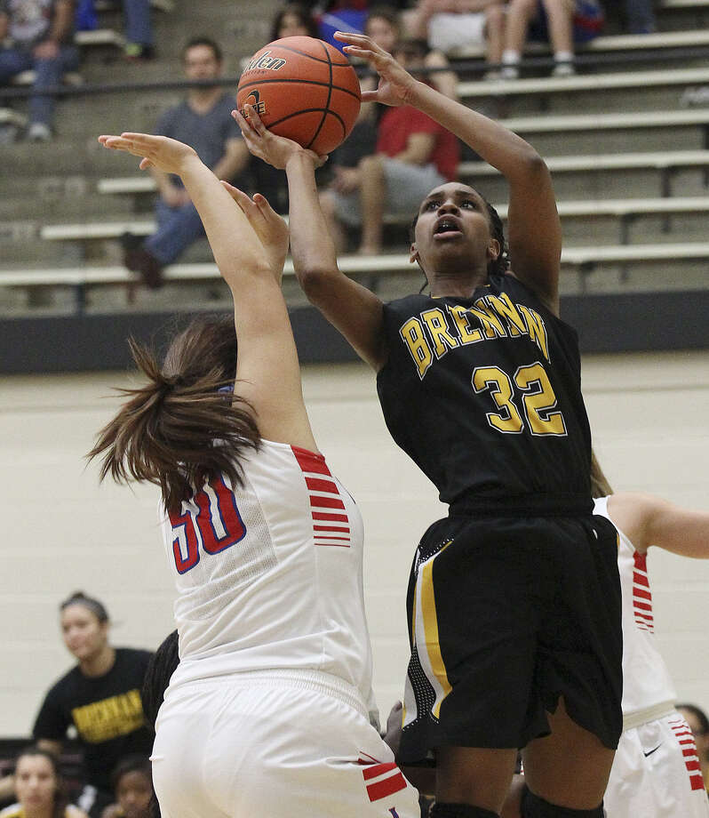 Brennan's Tanaeya Boclair, who led the Bears with 16 points, takes a shot over Leander's Kennedie Guerrero in the Region IV-4A final at Littleton Gym. Photo: Kin Man Hui / San Antonio Express-News / ©2013 San Antonio Express-News