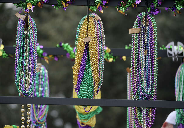 Beads hang from hooks on a float Saturday afternoon. Orange held its annual Mardi Gras parade on Saturday, with Seattle Seahawks safety and Orange native Earl Thomas III riding as a guest of honor. After the parade, Mayor Jimmy Sims presented a proclamation making February 22 the city's official Earl Thomas III Day. Photo taken Saturday, 2/22/14 Jake Daniels/@JakeD_in_SETX Photo: Jake Daniels / ©2013 The Beaumont Enterprise/Jake Daniels