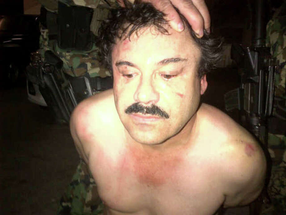 """Mexico's top drug lord, Joaquin """"El Chapo"""" Guzman, was arrested Saturday, bringing an end to a decade-long hunt for the man who helped start Mexico's modern drug war. Guzman, whose expansion efforts after his escape from prison in 2001 sparked bloody street wars in cities along Mexico's border with Texas, was arrested by Mexican marines in a resort town on Mexico's Pacific coast. To read more about Guzman, his battles along the Texas border and what his arrest means for the drug war, go to expressnews.com. Photo: New York Times / HANDOUT"""