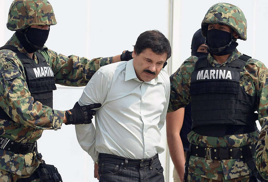 "Mexican drug trafficker Joaquín ""El Chapo"" Guzmán Loera is escorted by marines as he's presented to the media in Mexico City. Photo: Alfredo Estrella / Getty Images / ALFREDO ESTRELLA"