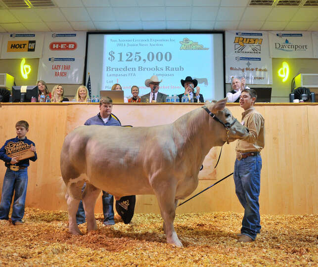 Braeden Raub (right), of Lampasas, has reason to smile Saturday as his grand champion steer, Beaver,