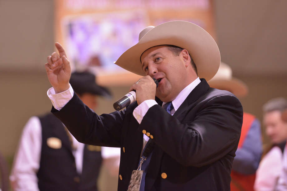 Auctioneer C. Jason Spence works at driving the price up during the San Antonio Stock Show and Rodeo Auction Saturday. Photo: For The San Antonio Express-News