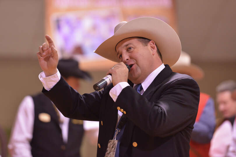 Auctioneer C. Jason Spence works at driving the price up during the San Antonio Stock Show and Rodeo