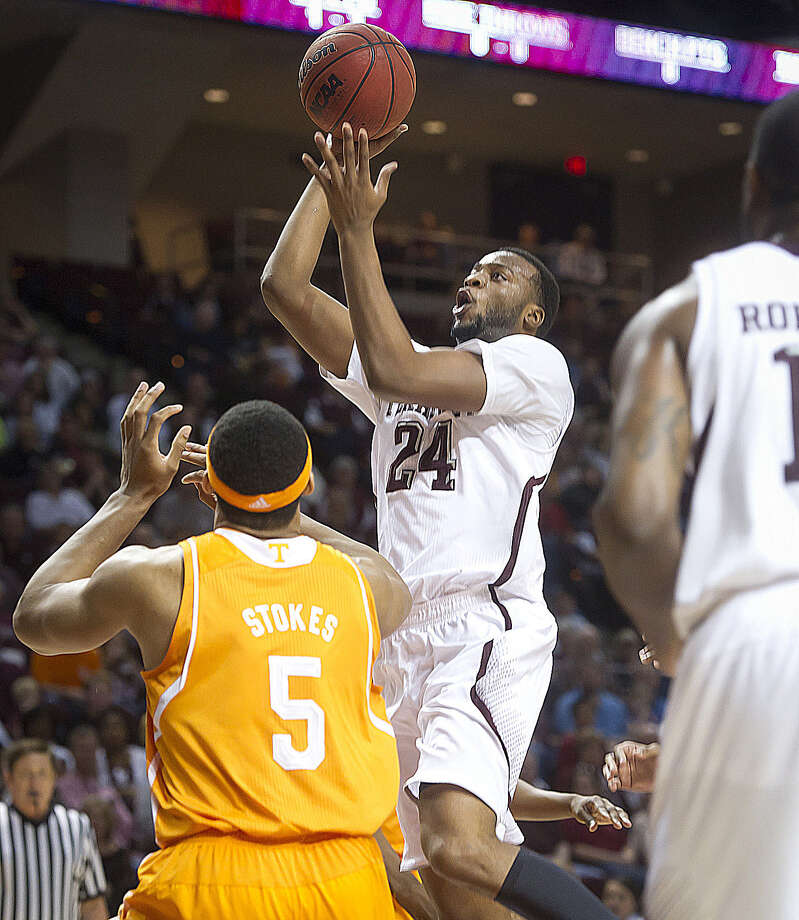Texas A&M's Antwan Space shoots over Jarnell Stokes in the first half. Space hit the game-winner over Stokes in overtime. Photo: Stuart Villanueva / Bryan-College Station Eagle / Bryan College Station Eagle