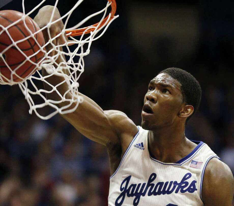 Kansas center Joel Embiid dunks in two of his 13 points against Texas on Saturday at Allen Fieldhouse. Embiid also grabbed seven rebounds and blocked six shots. Photo: Orlin Wagner / Associated Press / AP