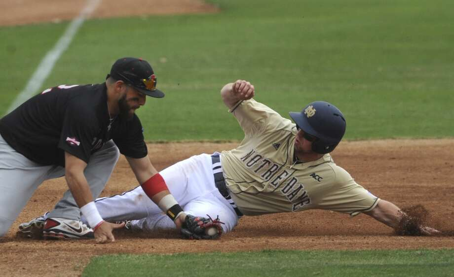 Incarnate Word third baseman 	Jonathan Armijo applies a tag to Blaise Lezynski of Notre Dame during first-inning action at the Irish Baseball Classic, played at Wolff Stadium on Saturday, Feb. 22, 2014. Lezynski was safe on stolen base attempt. Photo: San Antonio Express-News