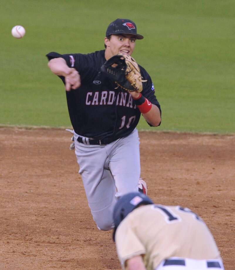 Bryce Shepherd of Incarnate Word turns a double play as Kyle Richardson of Notre Dame runs for second base during the Irish Baseball Classic at Wolff Stadium on Saturday, Feb. 22, 2014. Notre Dame won the game, 8-2. Photo: San Antonio Express-News