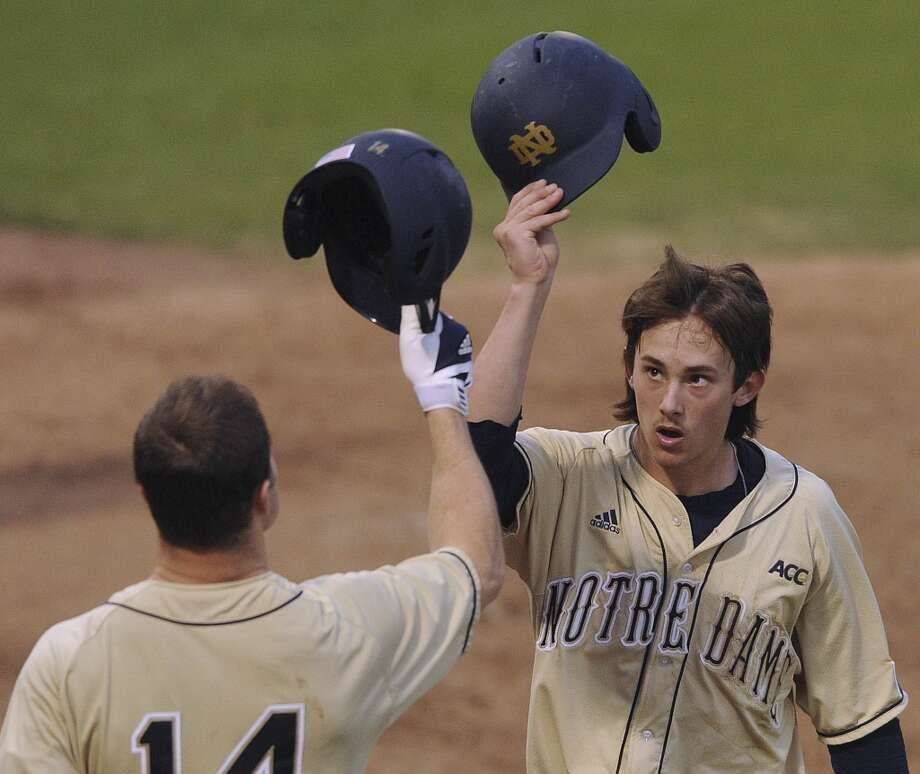 Cavan Biggio of Notre Dame gestures to teammate Kyle Richardson (14) after scoring against Incarnate Word during the Irish Baseball Classic, played at Wolff Stadium on Saturday, Feb. 22, 2014. Photo: San Antonio Express-News