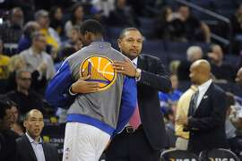 Warrior's head coach Mark Jackson gives a hug to #40 Harrison Barnes before their game against the Brooklyn Nets at Oracle Arena in Oakland, CA Saturday, February 22, 2014.
