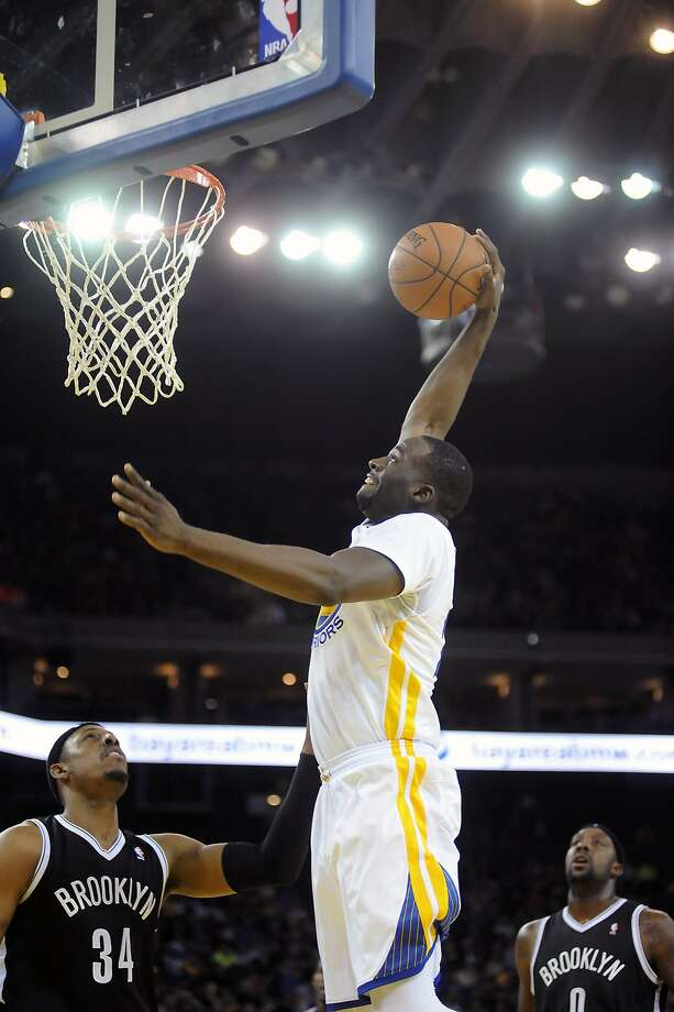 Draymond Green, dunking above Paul Pierce and Andray Blatche, scored a career-high 18 points and had 10 rebounds. Photo: Michael Short, Special To The Chronicle