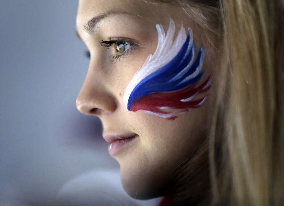 A Russian fan wears face paint while attending men's curling competition at the 2014 Winter Olympics, Monday, Feb. 17, 2014, in Sochi, Russia. Photo: Robert F. Bukaty, Associated Press