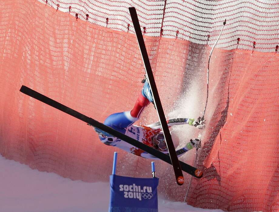 France's Marie Marchand-Arvier crashes into safety netting during the women's downhill at the Sochi 2014 Winter Olympics, Wednesday, Feb. 12, 2014, in Krasnaya Polyana, Russia. Photo: Charles Krupa, Associated Press