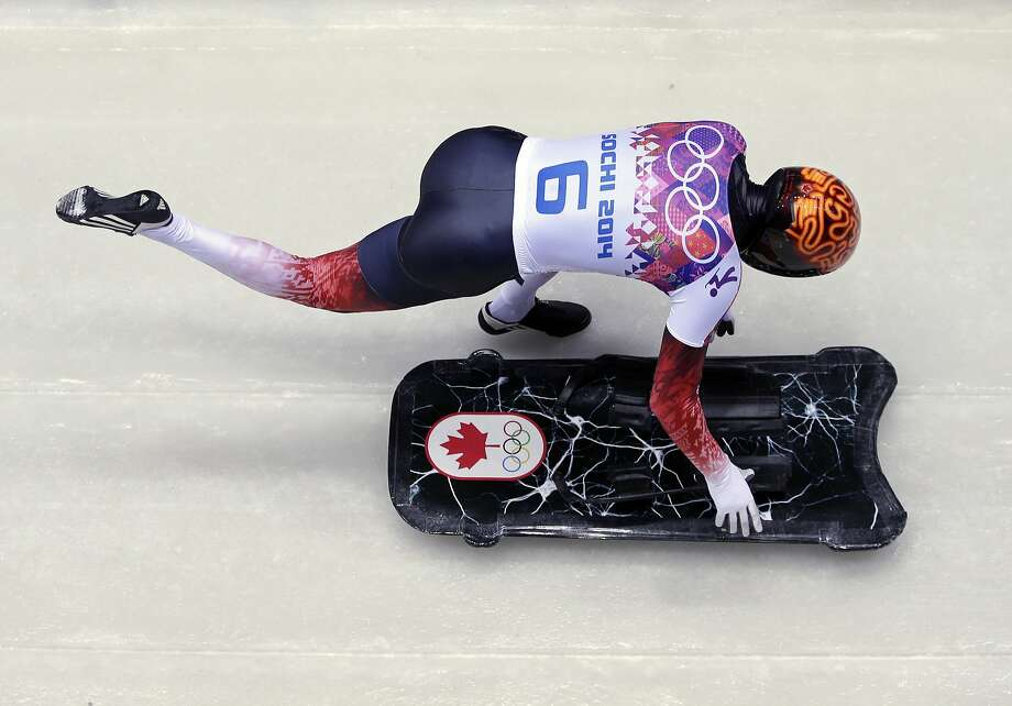 John Fairbairn of Canada starts his first run during the men's skeleton competition at the 2014 Winter Olympics, Friday, Feb. 14, 2014, in Krasnaya Polyana, Russia.  Photo: Michael Sohn, Associated Press