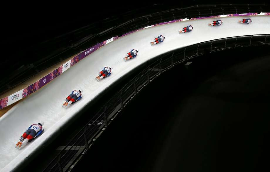 In this image made with a multiple exposure, Yun Sung-bin of South Korea speeds down the track during the men's skeleton final competition at the 2014 Winter Olympics, Saturday, Feb. 15, 2014, in Krasnaya Polyana, Russia.  ( Photo: Felipe Dana, Associated Press