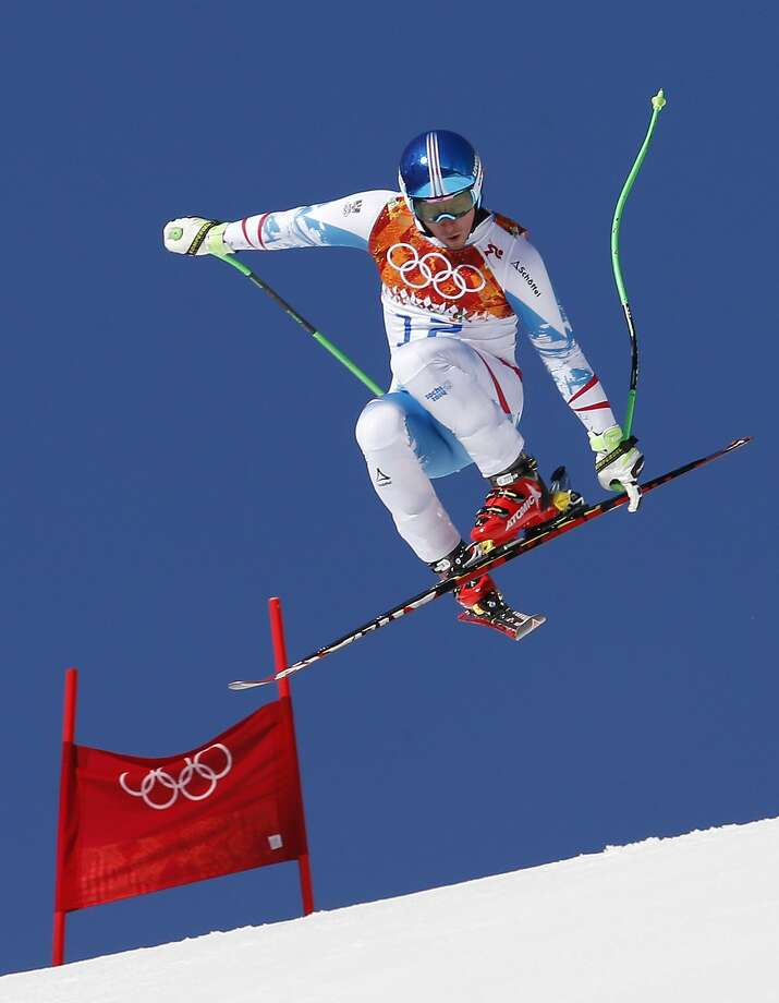 Austria's Matthias Mayer makes a jump during a men's downhill training run for the Sochi 2014 Winter Olympics, Saturday, Feb. 8, 2014, in Krasnaya Polyana, Russia. Photo: Uncredited, Associated Press