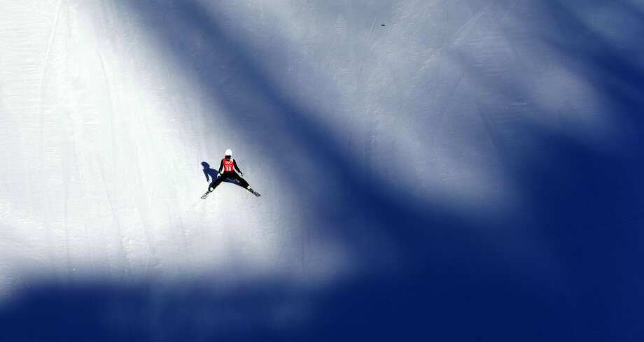 Japan's Sara Takanashi lands after her jump during a women's ski jumping training session at the 2014 Winter Olympics, Saturday, Feb. 8, 2014, in Krasnaya Polyana, Russia. Photo: Matthias Schrader, Associated Press