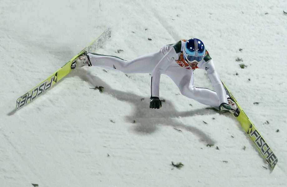 Slovenia's Robert Kranjec falls during the men's normal hill ski jumping qualification at the 2014 Winter Olympics, Saturday, Feb. 8, 2014, in Krasnaya Polyana, Russia.  Photo: Gregorio Borgia, Associated Press