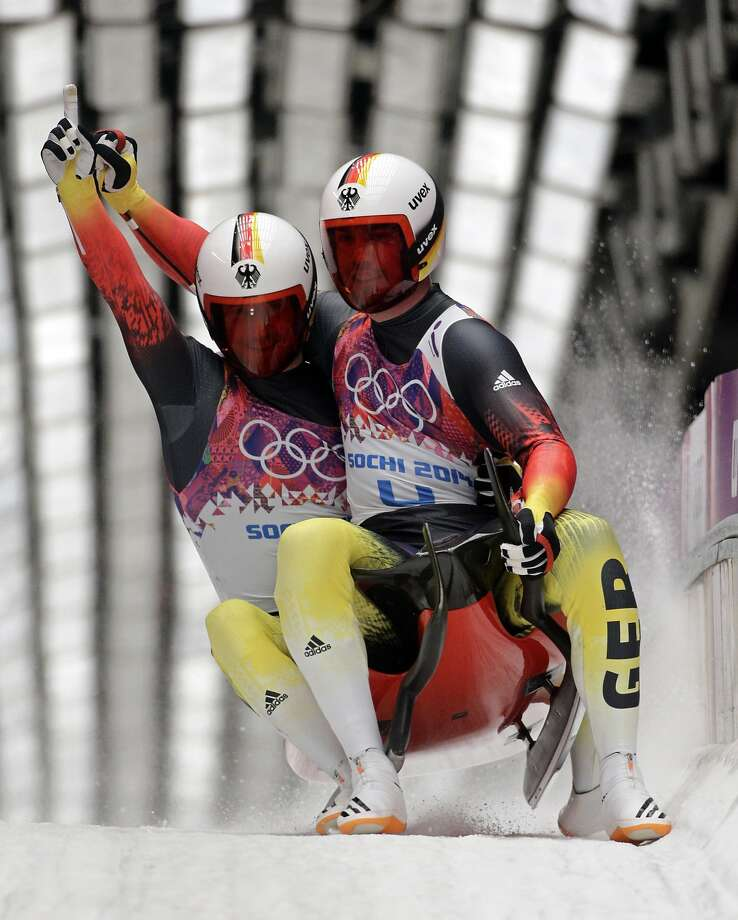 The doubles team of Tobias Wendl and Tobias Arlt from Germany brake in the finish area after their final run to win the gold medal during the men's doubles luge at the 2014 Winter Olympics, Wednesday, Feb. 12, 2014, in Krasnaya Polyana, Russia. Photo: Jae C. Hong, Associated Press