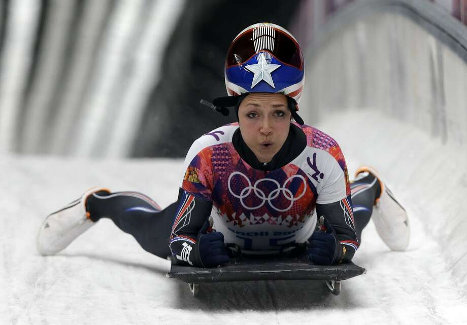 Katie Uhlaender of the United States brakes after her final run during the women's skeleton competition at the 2014 Winter Olympics, Friday, Feb. 14, 2014, in Krasnaya Polyana, Russia. Photo: Dita Alangkara, Associated Press