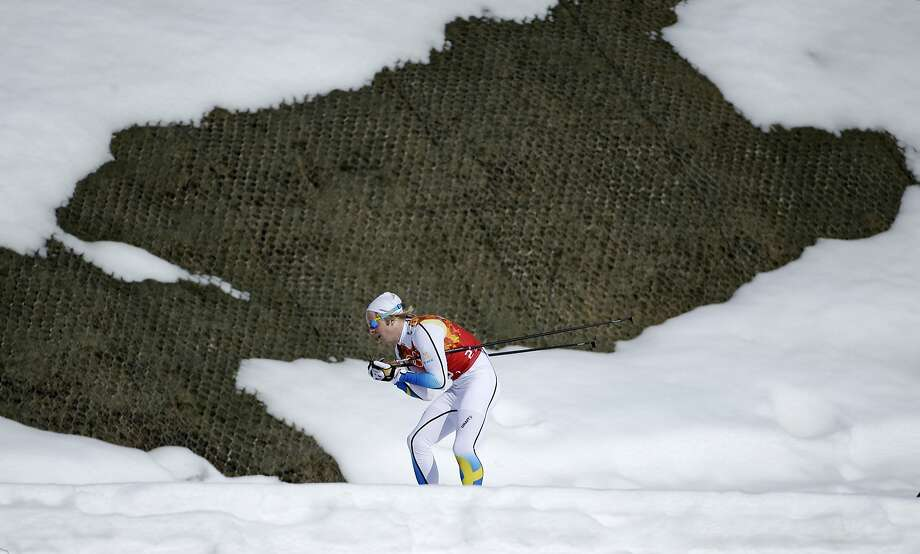 Sweden's Lars Nelson skis past a hole in the snow during the men's 4x10K cross-country relay at the 2014 Winter Olympics, Sunday, Feb. 16, 2014, in Krasnaya Polyana, Russia.  Photo: Gregorio Borgia, Associated Press