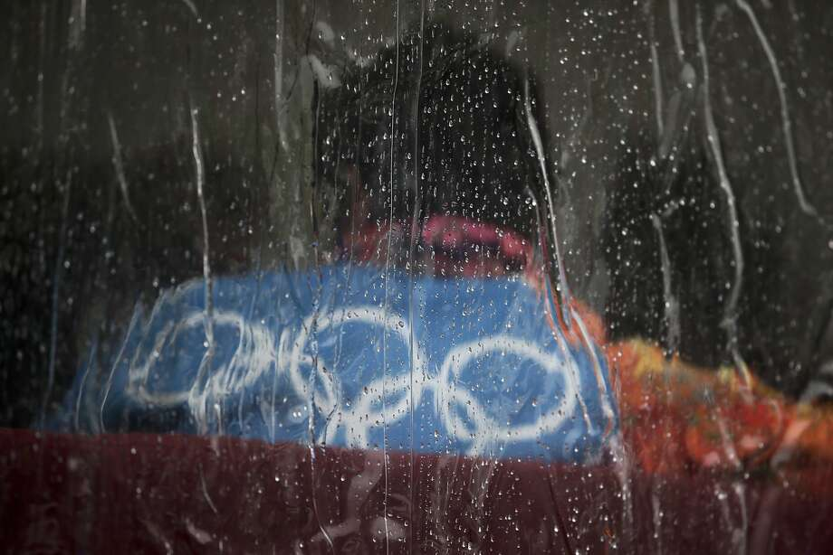 Raindrops roll down on the vinyl window of a tent at the Rosa Khutor Extreme Park, at the 2014 Winter Olympics, Tuesday, Feb. 18, 2014, in Krasnaya Polyana, Russia.  Photo: Jae C. Hong, Associated Press