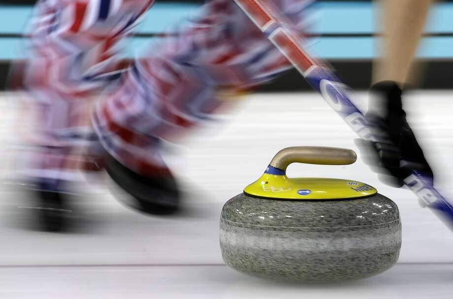 Norway's Haavard Vad Petersson sweeps  during a round robin session against the Great Britain at the 2014 Winter Olympics, Sunday, Feb. 16, 2014, in Sochi, Russia.  Photo: Morry Gash, Associated Press