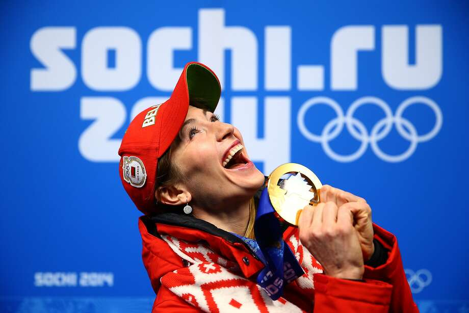 Gold medalist Darya Domracheva of Belarus celebrates during the medal ceremony for the Biathlon Women's 15km Individual on day 8 of the Sochi 2014 Winter Olympics at Medals Plaza on February 15, 2014 in Sochi, Russia. Photo: Clive Mason, Getty Images