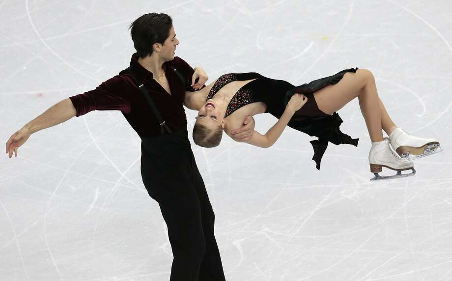 Kaitlyn Weaver and Andrew Poje of Canada compete in the ice dance free dance figure skating finals at the Iceberg Skating Palace during the 2014 Winter Olympics, Monday, Feb. 17, 2014, in Sochi, Russia. (AP Photo/Ivan Sekretarev) Photo: Ivan Sekretarev, Associated Press