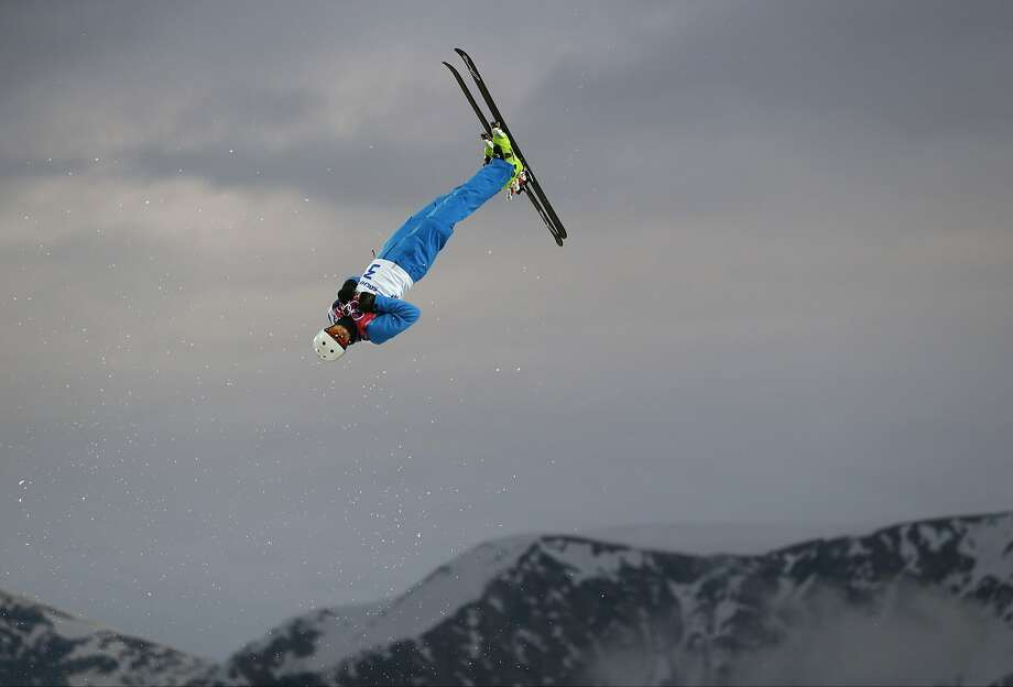 Anton Kushnir of Belarus jumps during men's freestyle skiing aerials qualifying at the Rosa Khutor Extreme Park, at the 2014 Winter Olympics, Monday, Feb. 17, 2014, in Krasnaya Polyana, Russia.(AP Photo/Sergei Grits) Photo: Sergei Grits, Associated Press