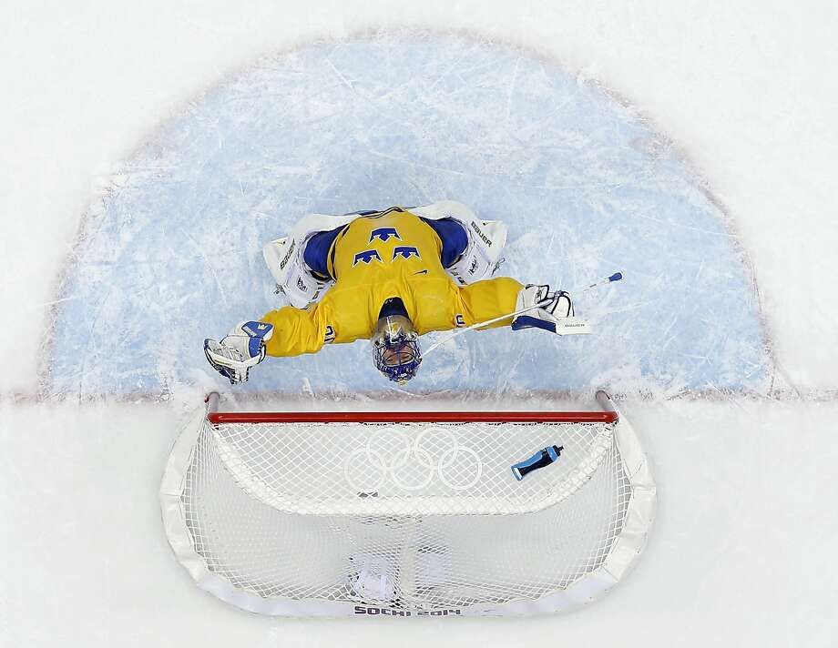 Sweden goaltender Henrik Lundqvist reacts after a men's semifinal ice hockey game against Finland at the 2014 Winter Olympics, Friday, Feb. 21, 2014, in Sochi, Russia. Sweden won 2-1 to advance to the gold medal game. (AP Photo/David J. Phillip_ ) Photo: David J. Phillip, Associated Press