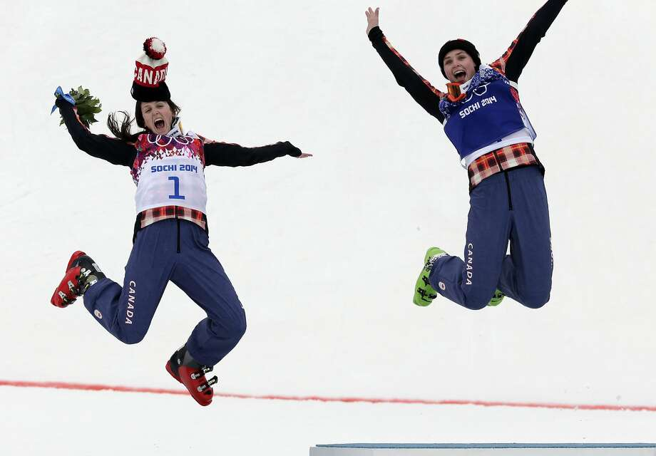 Women's ski cross gold medalist Marielle Thompson of Canada, right, celebrates on the podium with silver medalist and compatriot Kelsey Serwa, left, at the Rosa Khutor Extreme Park, at the 2014 Winter Olympics, Friday, Feb. 21, 2014, in Krasnaya Polyana, Russia. (AP Photo/Andy Wong) Photo: Andy Wong, Associated Press