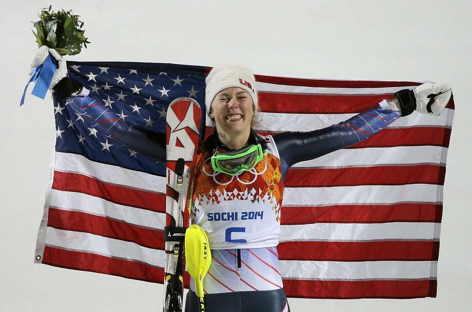 Women's slalom gold medal winner Mikaela Shiffrin of the United States poses for photographers with the American flag at the Sochi 2014 Winter Olympics, Friday, Feb. 21, 2014, in Krasnaya Polyana, Russia.(AP Photo/Christophe Ena) Photo: Christophe Ena, Associated Press