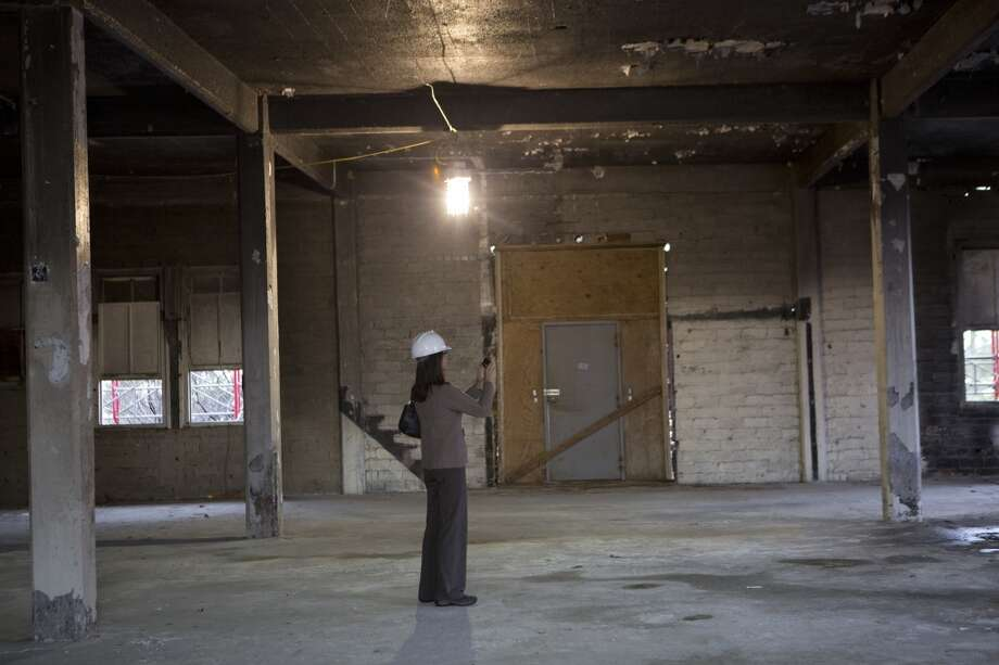 Sheila Turkiewicz director of theater operations at Houston First, photographs the renovation work done to the historic Sunset Coffee Building, Monday, Feb. 10, 2014, in Houston. ( Marie D. De Jesus / Houston Chronicle ) Photo: Marie D. De Jesus, Houston Chronicle