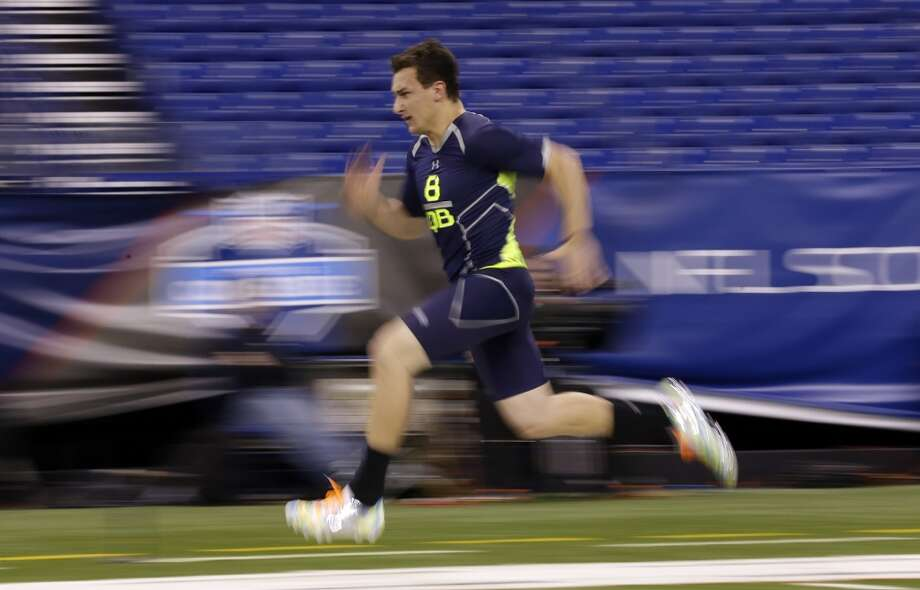 Former Texas A&M quarterback Johnny Manziel runs the 40-yard dash at the NFL combine. His unofficial time was 4.56 seconds. Photo: Michael Conroy, Associated Press