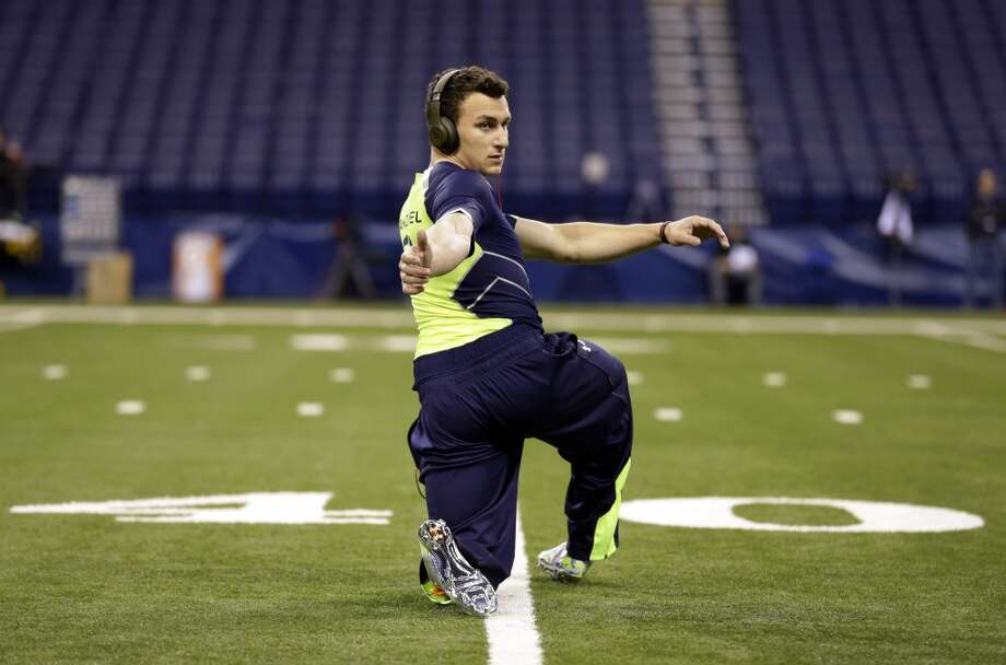 Former Texas A&M quarterback Johnny Manziel loosens up before taking part in drills at the NFL combine. Photo: Michael Conroy, Associated Press