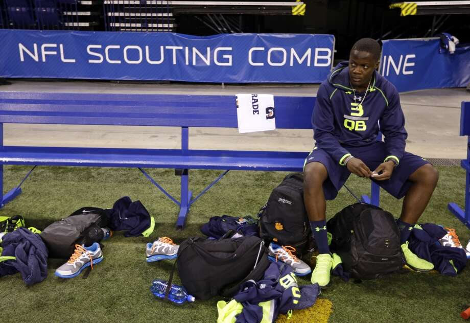Former Louisville quarterback Teddy Bridgewater sits on a bench before taking part in drills at the NFL combine. Photo: Michael Conroy, Associated Press