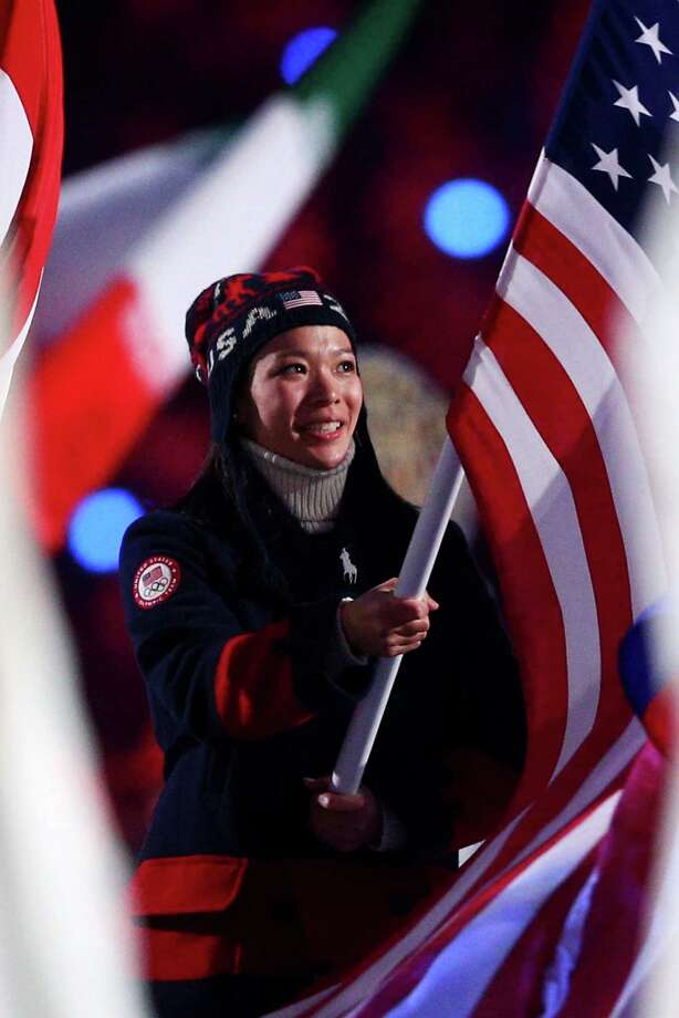Julie Chu, a Fairfield native and member of Team USA's women's hockey team enters with the American flag during the 2014 Sochi Winter Olympics Closing Ceremony at Fisht Olympic Stadium on February 23, 2014 in Sochi, Russia. Chu was one of a handful of Olympians with Connecticut ties to compete in the games. Photo: Paul Gilham, Getty Images / Getty Images