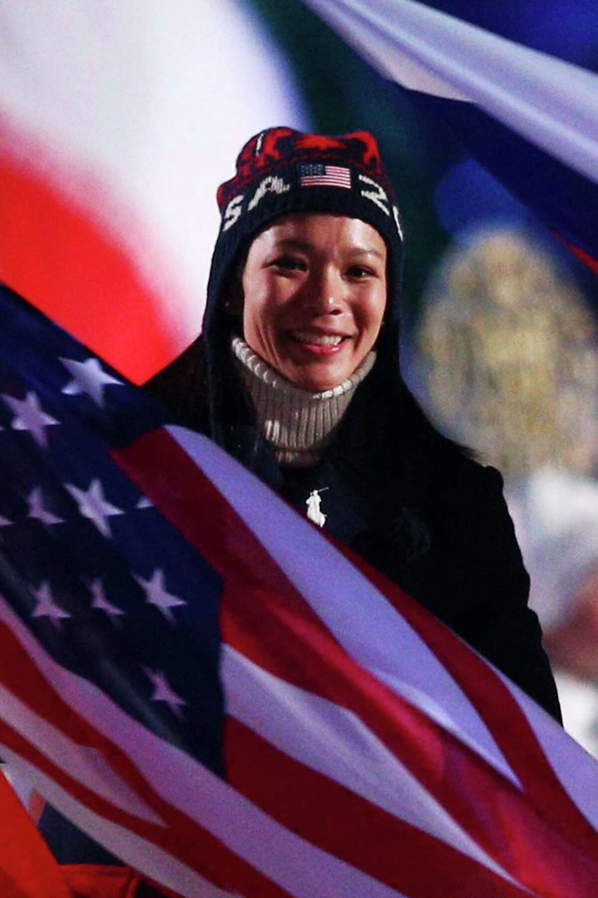 Hockey player Julie Chu of Fairfield entered with the flag during the 2014 Sochi Winter Olympics Closing Ceremony at Fisht Olympic Stadium on February 23, 2014 in Sochi, Russia.