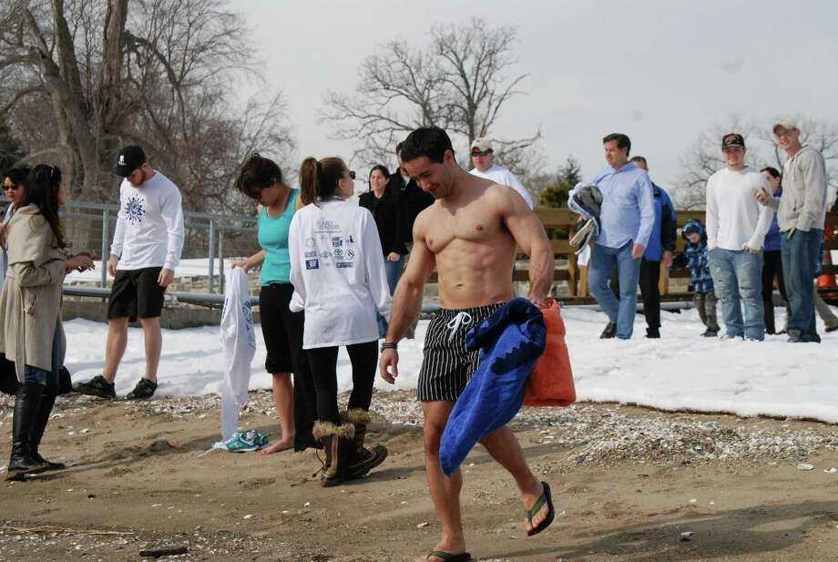 The third annual Polar Bear Plunge to benefit the Family Centers took place on Sunday, Feb. 23, 2014 at Cummings Point in Stamford. Family Centers' programs provide education, health and counseling services to Fairfield County children and families. Family Centers is located in Greenwich. Were you SEEN at the Polar Bear Plunge? Photo: BarkeyPowell/Hearst Connecticut Media Group