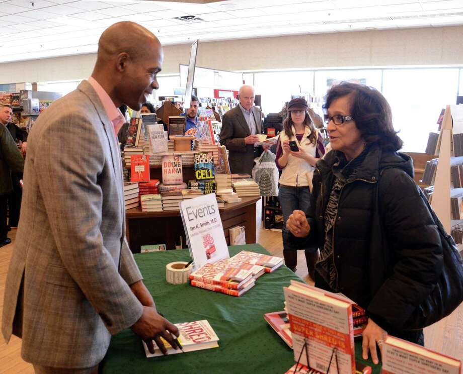 "Dr. Ian Smith a #1 New York Times and Amazon bestselling author and Danbury native was at Barnes & Noble for a special book signing for his newest diet book, ""Super Shred!"". Smith signs a book for Myrtle Robs from Danbury on Saturday, Feb. 22, 2014. Photo: Lisa Weir / The News-Times Freelance"
