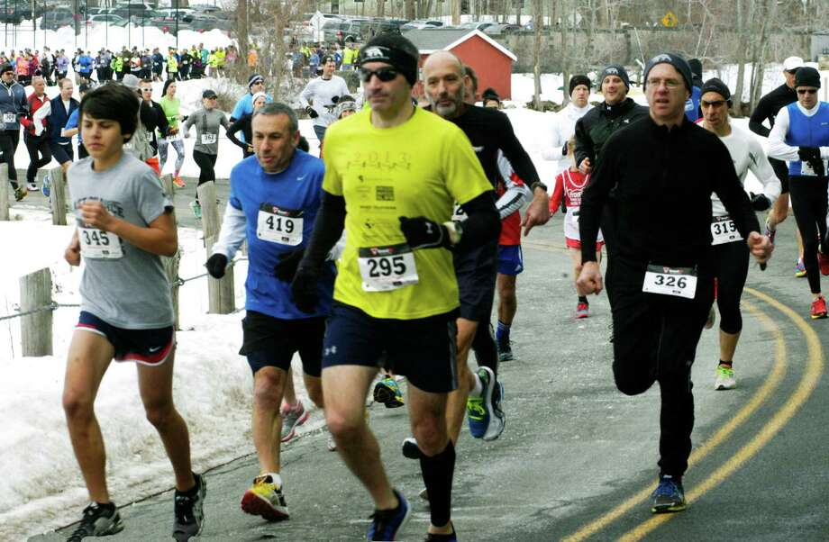 A record field of 472 runners toed the line along the shores of Lake Waramaug Sunday, Feb. 23, 2014, to participate in the annual Polar Bear road race around the lake. Photo: Norm Cummings / The News-Times