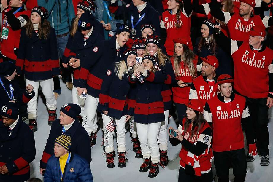 U.S. and Canadian Olympians enter the Fisht Stadium as part of the 2014 Sochi Winter Olympics Closing Ceremony at Fisht Olympic Stadium on February 23, 2014 in Sochi, Russia. Photo: Joe Scarnici, Getty Images