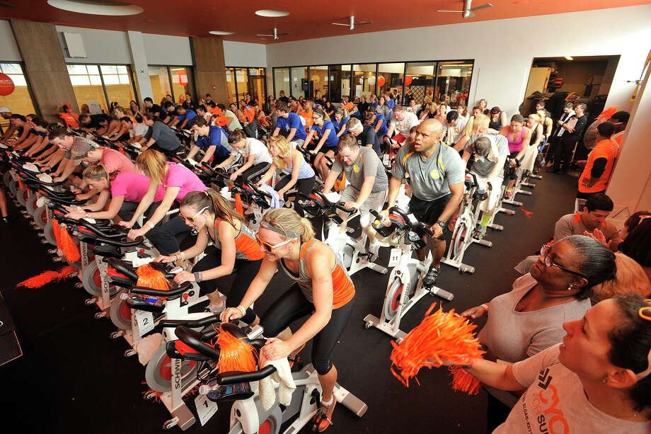 A room of cyclists participate in the Cycle for Survival event benefiting Memorial Sloan Kettering Cancer Center at Equinox fitness center in Greenwich, Conn., on Sunday, Feb. 23, 2014. Nationally, Cycle for Survival has raised over $47 million for rare cancer research since 2007. Photo: Jason Rearick / Stamford Advocate
