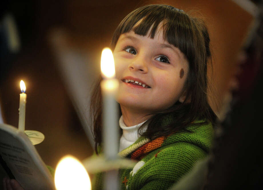 Anna Gali, 5, of North Haven, smiles as she looks over at her parents during a memorial service for the Ukrainian dead at St. Michael's Ukrainian Church in New Haven, Conn. on Sunday, February 23, 2014. Photo: Brian A. Pounds / Connecticut Post